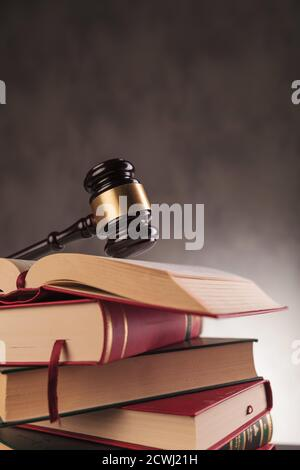 wooden hammer of a judge on a pile of books, studying law concept