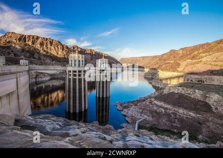 Reflection of the Hoover Dam and surrounding mountains on the surface of Lake Mead on the Arizona and Nevada border.