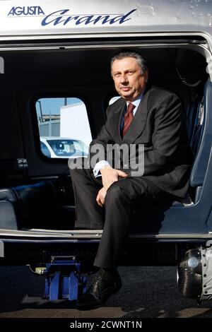 Finmeccanica Chairman and Chief Executive Officer Giuseppe Orsi poses in a helicopter during the opening ceremony of the new Terminal of Vertiporto dell'Urbe in Rome January 19, 2009. The new head of Italian defence group Finmeccanica  has inherited a corruption crisis over a $750 million (483.7 million pounds) helicopter deal with India that risks hurting the company's business in other foreign markets. Italy's second largest corporate employer moved chief operating officer Alessandro Pansa into the top job after police arrested CEO and Chairman Giuseppe Orsi on  February 12, 2013. Picture ta - Stock Photo