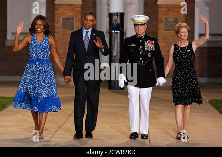U.S. President Barack Obama (2nd L) and first lady Michelle Obama arrive with Commandant of the Marine Corps General James Amos and his wife Bonnie at the Marine Barracks in Washington, June 27, 2014. REUTERS/Yuri Gripas (UNITED STATES - Tags: POLITICS MILITARY MARITIME TPX IMAGES OF THE DAY) - Stock Photo