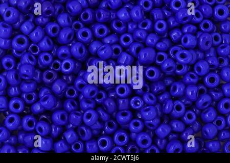 Blue Beads on the white background. Background or texture of beads. Close up, macro,It is used in finishing fashion clothes. make bead necklace or str