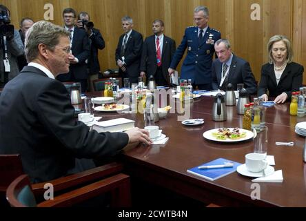 U.S. Secretary of State Hillary Clinton and German Foreign Minister Guido Westerwelle (L) hold a meeting on the sidelines of NATO Foreign Minister meetings at the Ministry of Foreign Affairs in Berlin April 15, 2011.   REUTERS/Saul Loeb/Pool   (GERMANY - Tags: POLITICS) - Stock Photo