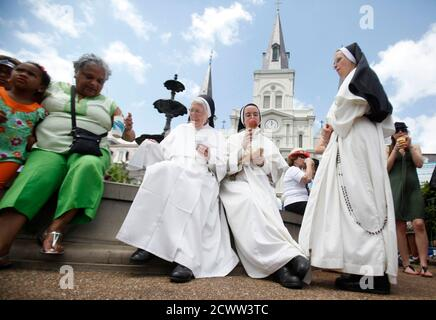 Dominican Sisters at the St. Louis Cathedral Academy enjoy ice cream during the 29th annual French Quarter Festival in New Orleans, Louisiana April 14, 2012. More than 500,000 people are expected to pack the French Quarter this weekend. Picture taken April 14, 2012.  REUTERS/Sean Gardner (UNITED STATES - Tags: SOCIETY) Stock Photo