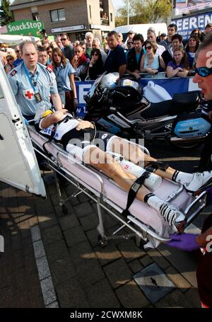 Veranda Willems Rider Sjef De Wilde Of Belgium Is Assisted By Rescuers After Crashing A Few