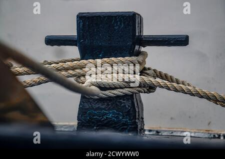 Close up of the boat bollard with a rope tied around it. Connection visual concept as boat tied and linked to the pontoon.