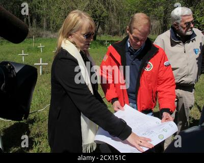 Dr. Erin Kimmerle (L), a forensic anthropologist from the University of South Florida shows a map of the graveyard to U.S. Senator Bill Nelson (D-Fla.), during a tour of the closed Dozier School for Boys in Marianna, Florida March 27, 2013.  An investigation is underway into the deaths of juvenile offenders who were beaten and abused at the Panhandle institution in the early part of the last century.  REUTERS/Bill Cotterell  (UNITED STATES - Tags: CRIME LAW EDUCATION SOCIETY)