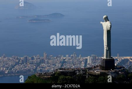 Tourists visit the Christ the Redeemer statue in Rio de Janeiro February 26, 2015. Rio de Janeiro will celebrate its 450th anniversary on March 1. REUTERS/Ricardo Moraes (BRAZIL - Tags: ANNIVERSARY SOCIETY TRAVEL CITYSCAPE) - Stock Photo