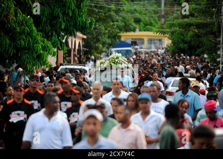 Family and friends of St. Louis Cardinals' outfielder Oscar Taveras accompany his coffin during his funeral in the town of Sosua, Puerto Plata province, October 28, 2014. Taveras, 22, was killed Sunday night along with Yamaly Arvelo, 18, while driving a 2014 Chevrolet Camaro on the tourist road Sosua-Puerto Plata on the north coast of Dominican Republic, police said. St. Louis Cardinals manager Mike Matheny on Monday called the death of Oscar Taveras, a top prospect killed in a car accident, 'a horrible loss of a life.' REUTERS/Ricardo Rojas (DOMINICAN REPUBLIC - Tags: SPORT BASEBALL OBITUARY)