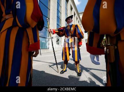 Former Swiss Guards Dominique Caron (C) repeats their moves for their bi-annual General Assembly in Lausanne August 31, 2013. The Association of Former Swiss Guards was founded in 1921 and currently has around 1000 members that meet up once every two years for a meeting at a Swiss city. The Swiss Guard, which was founded in 1506, consists of 100 volunteers who must be Swiss nationals, Catholic, single, at least 174 cm (5.7 ft) tall and beardless. New recruits are sworn in every year on May 6, commemorating the date on which 147 Swiss soldiers died defending the Pope during an attack on Rome on - Stock Photo