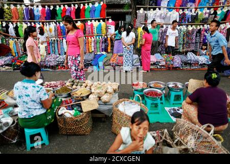 People shop at an open air market in Myitkyina, the capital of Kachin State July 8, 2013.  REUTERS/Damir Sagolj (MYANMAR - Tags: SOCIETY) Stock Photo