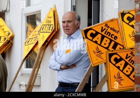 Liberal Democrat candidate for Twickenham, Vince Cable, waits for party leader Nick Clegg to arrive for campaigning, in London, Britain May 4, 2015. Britain will go to the polls in a national election on May 7. REUTERS/Peter Nicholls - Stock Photo
