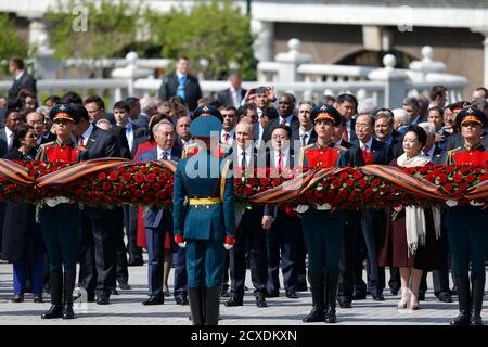 Russian President Vladimir Putin (C), Mongolia's President Tsakhiagiin Elbegdorj (5th R), United Nations Secretary General Ban Ki-moon (3rd R), Kazakhstan's President Nursultan Nazarbayev (4th L) and other officials take part in a wreath laying ceremony on the Victory Day by the Kremlin walls in central Moscow, Russia, May 9, 2015. Russia marks the 70th anniversary of the end of World War Two in Europe on Saturday with a military parade, showcasing new military hardware at a time when relations with the West have hit lows not seen since the Cold War. REUTERS/Maxim Shemetov - Stock Photo
