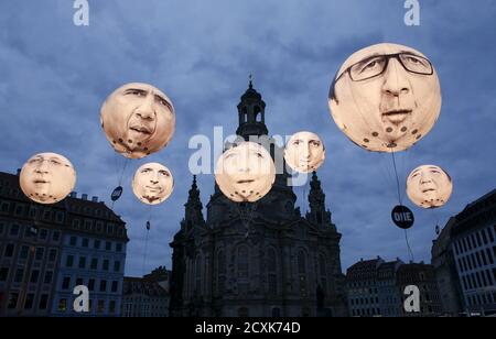 Balloons made by the 'ONE' campaigning organisation depicting leaders of the countries members of the G7 are seen in front of the Frauenkirche cathedral May 27, 2015. Dresden hosts the G7 finance ministers and central bankers meeting. The balloons show Japanese Prime Minister Shinzo Abe (R), British Prime Minister David Cameron (5th L), French President Francois Hollande (2nd R), German Chancellor Angela Merkel (4th L), U.S. President Barack Obama (2nd L), Italian Prime Minister Matteo Renzi (3rd L) and Canadian Prime Minister Stephen Harper (L). REUTERS/Fabrizio Bensch