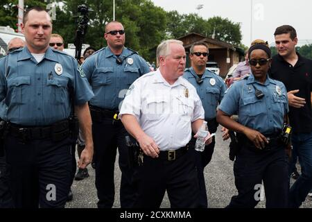 Ferguson Police Chief Thomas Jackson (C) walks away from a media availability regarding his office's handling of the release of information following the shooting of Michael Brown in Ferguson, Missouri August 15, 2014. Picture take August 15, 2014. REUTERS/Lucas Jackson (UNITED STATES - Tags: CIVIL UNREST CRIME LAW POLITICS)