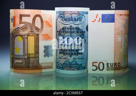 One hundred Mark note and fifty Euros notes are seen in this photo illustration taken in Berlin on December 30, 2011. Ten years ago Saturday, the European Union celebrated the launch of the first euro coins. REUTERS/Pawel Kopczynski (GERMANY - Tags: BUSINESS) - Stock Photo