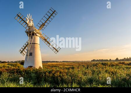 Sunrise at Thurne Mill. Built in 1820 and sitting next to the river Thurne, Norfolk Broads, Norfolk, England. - Stock Photo