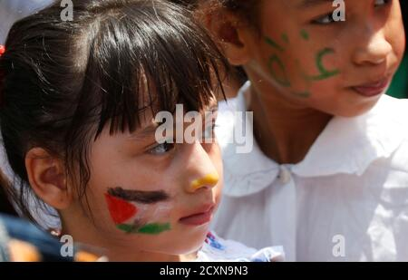 A girl, with her face painted with the Palestinian flag, stands next to another girl with the word 'Gaza' on her face, during a demonstration organised by Lebanese Sunni Islamists and Palestinians to denounce Israeli air strikes on the Gaza strip, in Lebanon's southern port-city of Sidon July 11, 2014. The United Nations human rights chief on Friday voiced serious doubts that Israeli's military operation against Gaza complied with international law banning the targeting of civilians, and called on both sides to step back from the brink. REUTERS/Ali Hashisho   (LEBANON - Tags: POLITICS CIVIL UN - Stock Photo