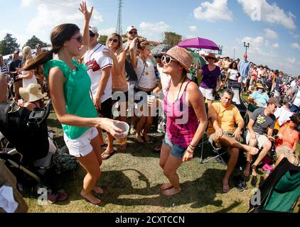 Angele Henning (L) dances with Julie Lacoste while enjoying musician Kermit Ruffins's performance during the 29th annual French Quarter Festival in New Orleans, Louisiana April 14, 2012. More than 500,000 people are expected to pack the French Quarter this weekend. REUTERS/Sean Gardner (UNITED STATES - Tags: ENTERTAINMENT SOCIETY TRAVEL) Stock Photo