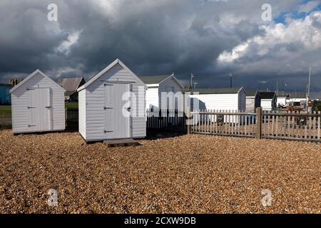 A Group of Fisherman's Huts  on Walmer Beach, illuminated against a lowering Sky