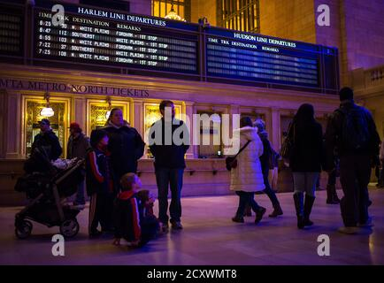 People and an empty electronic display for the Hudson line are seen in Grand Central Station after a Metro-North train derailment in the Bronx borough of New York December 1, 2013. A suburban New York train derailed on Sunday, killing four people and injuring 63, including 11 critically, when all seven cars of the Metro-North train ran off the tracks on a sharp curve, officials said. The crash happened at 7:20 a.m. (1220 GMT) about 100 yards (metres) north of Metro North's Spuyten Duyvil station in the city's Bronx borough, said Metro North spokesman Aaron Donovan. REUTERS/Eric Thayer (UNITED  - Stock Photo