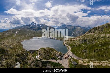 Aerial view of the lake at the top of the Grimsel pass between the cantons of Bern and Valais in the alps in Switzerland - Stock Photo