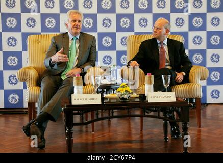 General Electric Co Chief Executive Jeff Immelt (L) speaks with the media as John Flannery, head of GE in India, watches in New Delhi February 22, 2013. General Electric Co expects revenues from the company's Indian business to grow between 15 and 20 percent on a 'sustainable basis', Immelt said on Friday. GE, which installed India's first hydro power plant in 1902, has Indian revenues of about $2.8 billion and employs about 15,000 people there. REUTERS/B Mathur (INDIA - Tags: BUSINESS ENERGY)