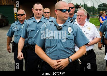 Ferguson Police Chief Thomas Jackson (R) walks away from a media availability regarding his office's handling of the release of information following the shooting of Michael Brown in Ferguson, Missouri August 15, 2014. Picture taken August 15, 2014.  REUTERS/Lucas Jackson (UNITED STATES - Tags: CIVIL UNREST CRIME LAW POLITICS)