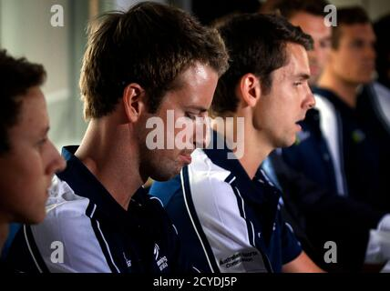 James Magnussen (2nd L) reacts as he sits with teammates Cameron McEvoy (L) and Eamon Sullivan (R) from Australia's 4x100m freestyle relay team at the London Olympic Games during a media conference at a hotel in Sydney February 22, 2013. Magnussen and his team mates from the relay squad have admitted using a sedative banned by their national Olympic committee in a bonding session before the London Games. REUTERS/David Gray (AUSTRALIA - Tags: SPORT SWIMMING OLYMPICS DRUGS SOCIETY) - Stock Photo