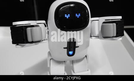 Modern robot with an electronic face with loving hearts eyes.