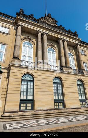 Facade of the Christian VIII Palace (Levetzau Palace) in Amalienborg, Copenhagen, Denmark - Stock Photo