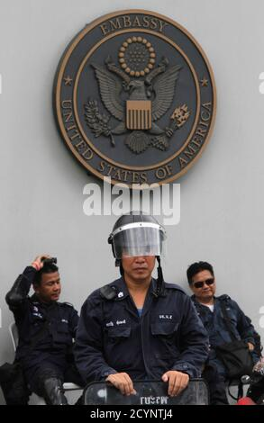 Riot police stand guard outside the U.S. embassy before a protest by a group of Muslims in Bangkok September 18, 2012. Demonstrators staged a peaceful protest against the anti-Islam film on Tuesday. Around 300 anti-American protesters holding Muslim flags and banners condemned America and chanted 'Allahu Akbar', which means God is great. REUTERS/Chaiwat Subprasom (THAILAND - Tags: RELIGION CIVIL UNREST POLITICS) - Stock Photo