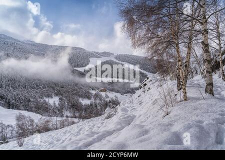 Aerial view the Pyrenees Mountains in Andorra , Grandvalira ski area in El Tarter one winter day .