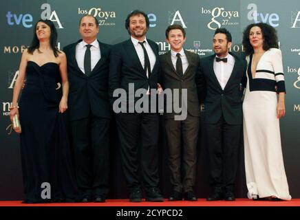 Spanish director Juan Antonio Bayona (2nd R) poses with 'Lo imposible' cast members including British actor Tom Holland (3rd R), producers Belen Atienza (L) and Alvaro Augustin (2nd L) on the red carpet as they arrive for the Spanish Film Academy's Goya Awards ceremony in Madrid, February 17, 2013. REUTERS/Sergio Perez (SPAIN - Tags: ENTERTAINMENT)