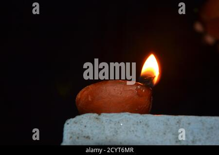 Oil lamps with flame. deepawali or diwali is celebrated by hindus by lighting the oil lamps.