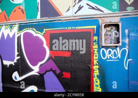 Graffiti street art tag on a wall