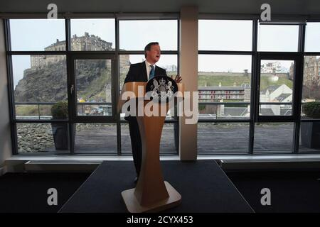 Britain's Prime minister David Cameron delivers a speech at the Apex Hotel in Edinburgh, Scotland February 16, 2012. Cameron delivered an impassioned plea to the Scots on Thursday in defence of the United Kingdom, enticing Scotland to reject independence with an offer to devolve more power to Edinburgh. REUTERS/Jeff J Mitchell/pool (BRITAIN - Tags: POLITICS SOCIETY) - Stock Photo