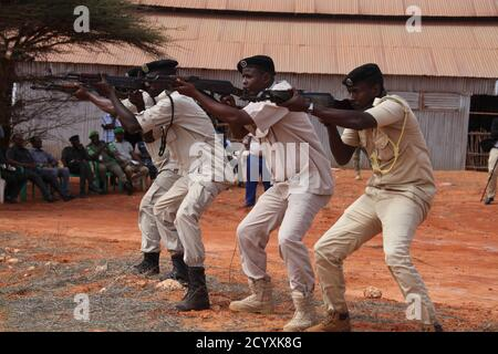 Somali Police trainees demonstrate skills acquired during a VIP Close Protection Course conducted by the African Union Mission in Somalia (AMISOM) Police Component in Kismaayo March 07, 2018. - Stock Photo