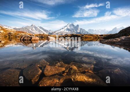 Incredible view of clear water and sky reflection on Lac Blanc lake in France Alps. Monte Bianco mountains range on background. Landscape photography, Chamonix. Stock Photo