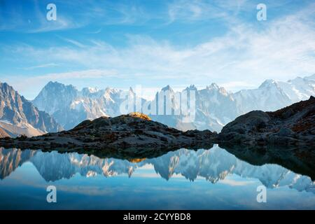 Incredible view of clear water and sky reflection on Chesery lake (Lac De Cheserys) in France Alps. Monte Bianco mountains range on background. Landscape photography, Chamonix. Stock Photo