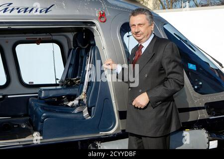 Finmeccanica Chairman and Chief Executive Officer Giuseppe Orsi poses next to a helicopter during the opening ceremony of the new Terminal of Vertiporto dell'Urbe in Rome January 19, 2009. The new head of Italian defence group Finmeccanica has inherited a corruption crisis over a $750 million (483.7 million pounds) helicopter deal with India that risks hurting the company's business in other foreign markets. Italy's second largest corporate employer moved chief operating officer Alessandro Pansa into the top job after police arrested CEO and Chairman Giuseppe Orsi on  February 12, 2013. Pictur - Stock Photo