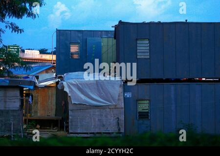 An Indonesian labourer rests outside his temporary accommodation near Shah Alam outside Kuala Lumpur May 6, 2014. REUTERS/Samsul Said (MALAYSIA - Tags: SOCIETY BUSINESS EMPLOYMENT) Stock Photo