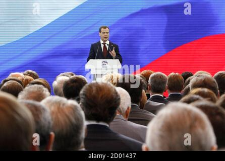 Russia's Prime Minister Dmitry Medvedev addresses the audience during a United Russia party congress in Moscow May 26, 2012.   REUTERS/Maxim Shemetov (RUSSIA  - Tags: POLITICS) - Stock Photo