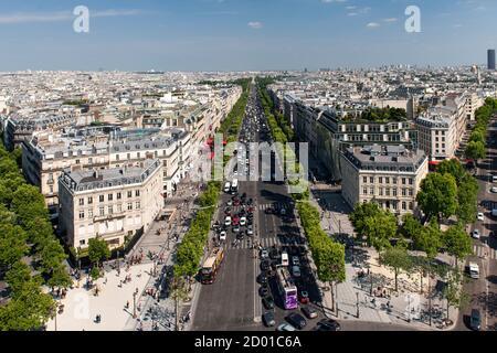 View down the Avenue des Champs Élysées from the top of the Arc De Triomphe in Paris. - Stock Photo