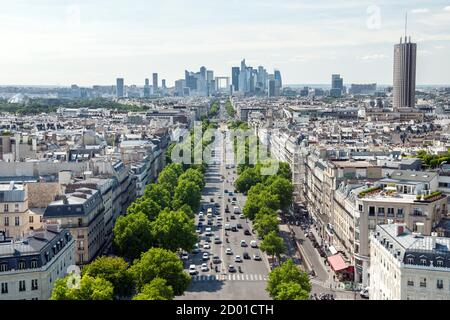 View from the top of the Arc De Triomphe down the Avenue de la Grande Armée towards la Grande Arche de la Défense in Paris. - Stock Photo