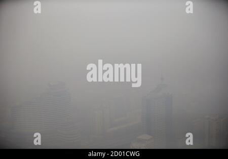 Buildings are seen from China Central Radio and Television Tower (CCTV Tower) on a polluted day in Beijing, January 15, 2015. Awareness of the dangers of Beijing's skies is on the rise, thanks to growing data on its air quality. China will 'declare war on pollution,' Premier Li Keqiang told parliament in an opening address in 2014. A tougher environmental law took effect on Jan. 1, while a new environment minister took charge on Friday. Picture taken on January 15, 2015. REUTERS/Kim Kyung-Hoon (CHINA - Tags: POLITICS SOCIETY ENVIRONMENT BUSINESS) - Stock Photo