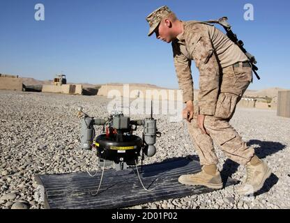 U.S. Marine Lance Corporal Paxton Force, of Fox Co, 2nd Battalion, 7th Marines Regiment checks T-Hawk, a surveillance drone camera at the Landing Zone of Combat Outpost Musa Qal-Ah in Helmand province, southwestern Afghanistan November 5, 2012. REUTERS/Erik De Castro  (AFGHANISTAN - Tags: MILITARY POLITICS CIVIL UNREST)