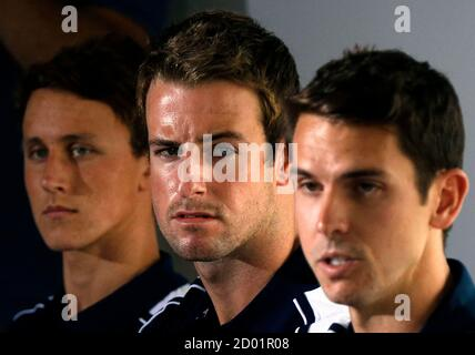 James Magnussen (C) sits with teammates Cameron McEvoy (L) and Eamon Sullivan (R) from Australia's 4x100m freestyle relay team at the London Olympic Games during a media conference at a hotel in Sydney February 22, 2013. Magnussen and his team mates from the relay squad have admitted using a sedative banned by their national Olympic committee in a bonding session before the London Games. REUTERS/David Gray (AUSTRALIA - Tags: SPORT SWIMMING DRUGS SOCIETY OLYMPICS TPX IMAGES OF THE DAY) - Stock Photo