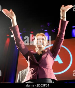 Social Democrat leader Helle Thorning-Schmidt celebrates after claiming victory in a parliamentary election at the party's election headquarters in Copenhagen September 15, 2011. Thorning-Schmidt is set to become Denmark's first female prime minister, having persuaded voters she fix can the economy to win a close election race and end 10 years of centre-right rule. REUTERS/Fabian Bimmer (DENMARK - Tags: POLITICS ELECTIONS) - Stock Photo