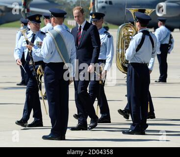 Prince William, the Duke of Cambridge, inspects the guard after arriving at Royal Australian Air Force Base Amberley near Brisbane, April 19, 2014. Britain's Prince William and his wife Catherine are undertaking a 19-day official visit to New Zealand and Australia with their son Prince George.  REUTERS/Dan Peled/Pool  (AUSTRALIA - Tags: ENTERTAINMENT ROYALS POLITICS) - Stock Photo