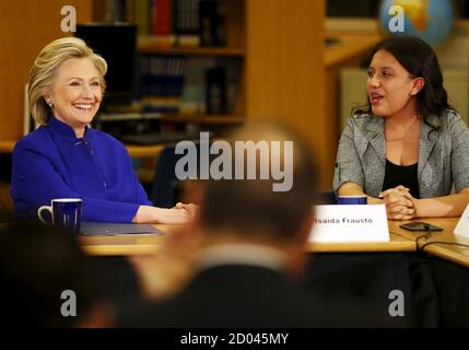 Former U.S. Secretary of State Hillary Clinton talks with 9th grade student Betsaida Frausto during a roundtable of young Nevadans discussing immigration, as she campaigns for the 2016 Democratic presidential nomination, at Rancho High School in Las Vegas, Nevada May 5, 2015.  REUTERS/Mike Blake - Stock Photo